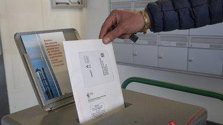 Votations fédérales: une forte participation de quelque 59%