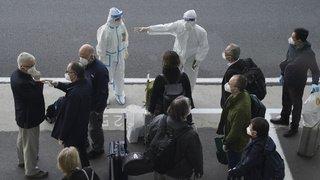 Origines du coronavirus: pourquoi 10 experts de l'OMS enquêtent en Chine