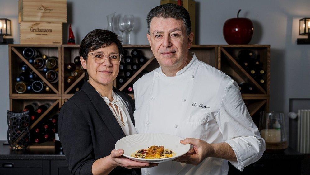 Cinzia Saccani et Enzo Buffarini passent de la petite auberge communale à la grande. Leur cuisine suisse et italienne cèdera la place à des mets belges à accorder avec de la bière.