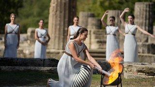 Flamme olympique, manif anti-pass en Italie, déconfinement à Sydney: la galerie photos du 18 octobre 2021