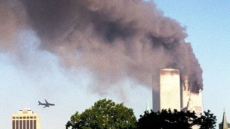 FILE - In this Tuesday, Sept. 11, 2001 file photo, United Airlines Flight 175 approaches the south tower of the World Trade Center in New York moments before collision, seen from the Brooklyn borough of New York. (AP Photo/ William Kratzke) === TUESDAY, SEPT. 11, 2001 FILE PHOTO; PART OF A PACKAGE OF FILE PHOTOS FOR USE WITH THE ANNIVERSARY OF SEPT. 11, 2001 ===
