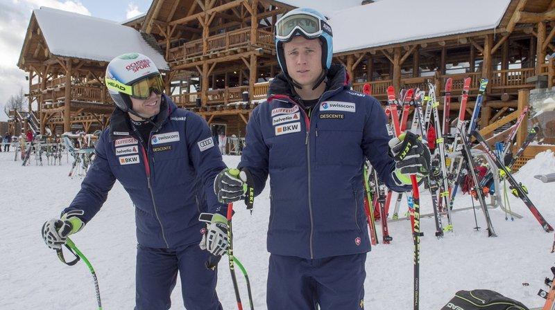 Les Suisses Nils Mani (à droite) et Ralph Weber, ainsi que tous les autres concurrents, doivent prendre leur mal en patience.