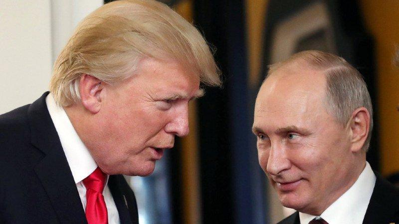 Vladimir Poutine (dr.) appelle Donald Trump au dialogue.