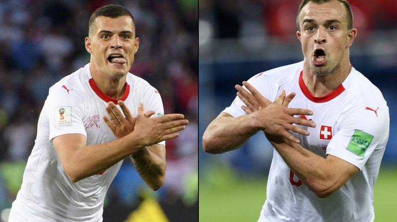 L'imitation de l'aigle albanais faite par Xhaka (g.) et Shaqiri (dr.) fâche la presse serbe.