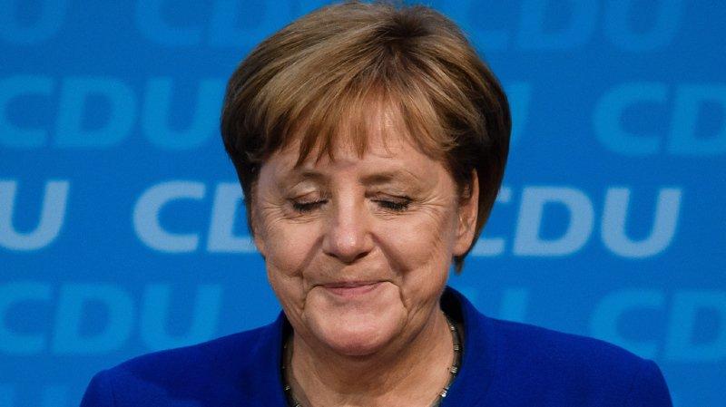 Allemagne: Merkel reste fragilisée après avoir sauvé son gouvernement