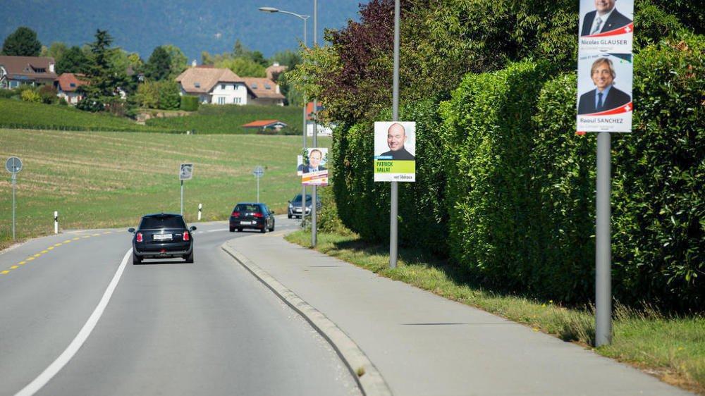 Les portraits des candidats aux élections fédérales fleurissent le long de la route de Divonne à Commugny, comme partout ailleurs dans le canton.