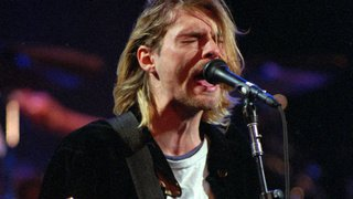 Enchères: un gilet en laine troué de Kurt Cobain mis en vente