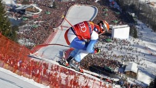 Enchères: les chaussures de ski de Didier Cuche vendues 1901 francs