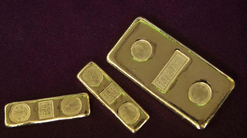 L'or profite aussi de la faiblesse du dollar (illustration).